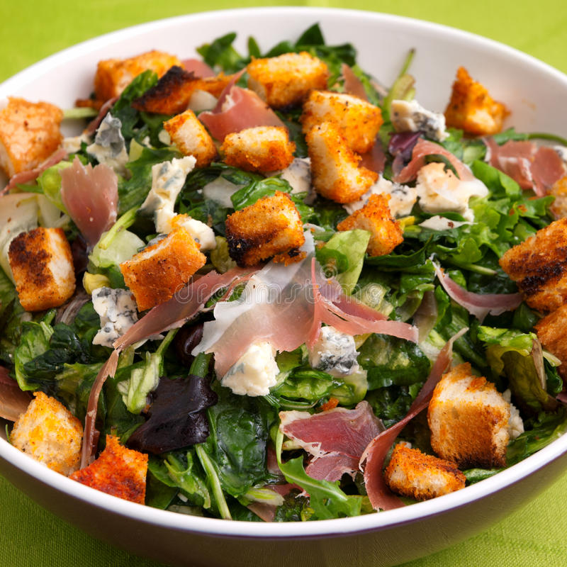 French Provencal Salad. With green salad, bacon, croutons and blue cheese. Close up, square shot stock image