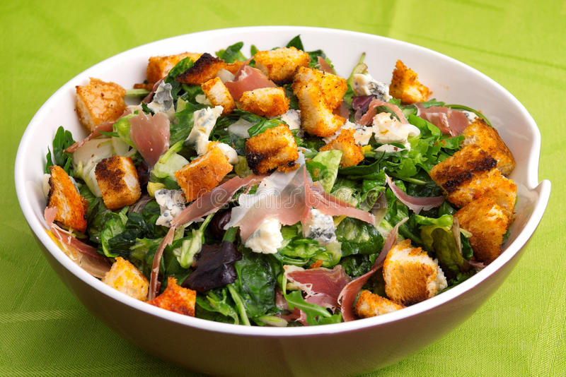 French Provencal Salad. With green salad, bacon, croutons and blue cheese. Full length view stock photos