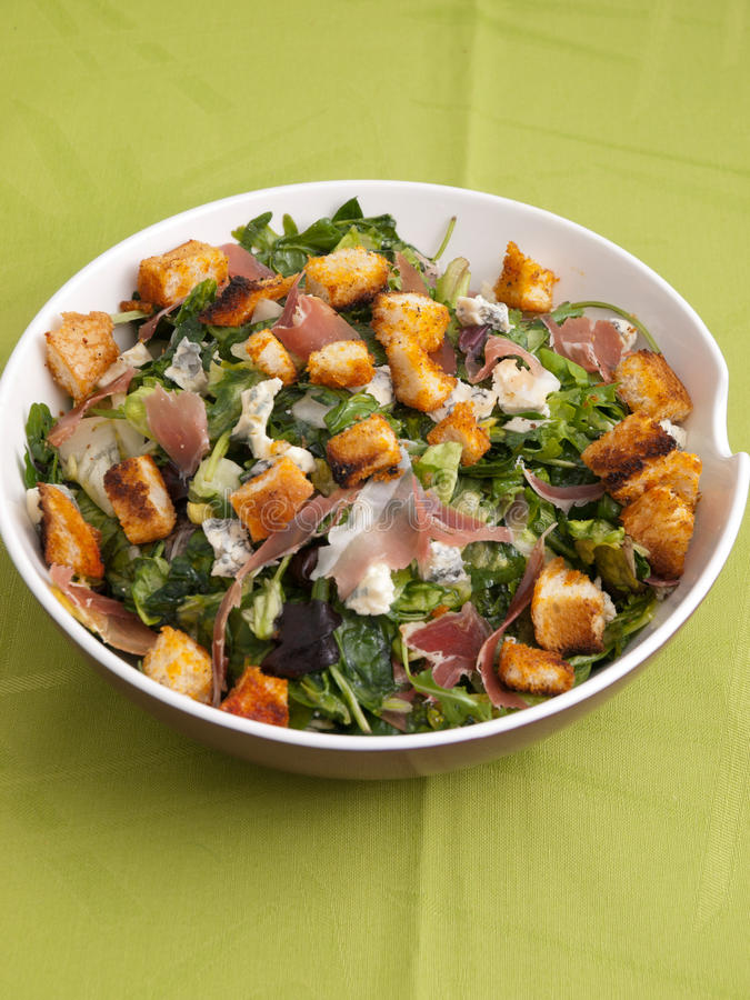 French Provencal Salad. With green salad, bacon, croutons and blue cheese. Full length view. Vertical shot stock photo