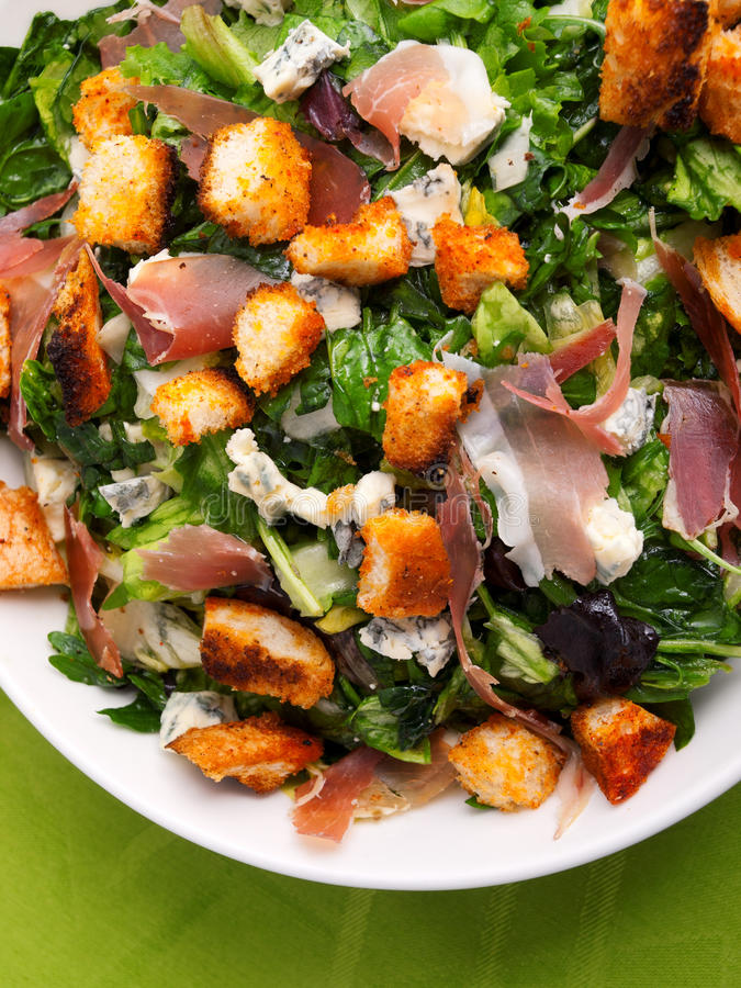 French Provencal Salad. With green salad, bacon, croutons and blue cheese. Shot from above, vertical view royalty free stock images