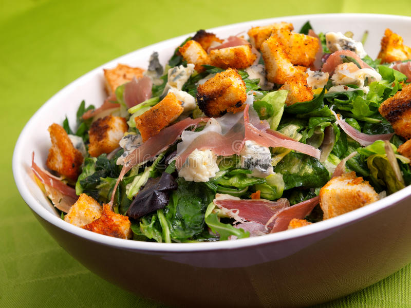 French Provencal Salad. With green salad, bacon, croutons and blue cheese. Tilted view royalty free stock photography