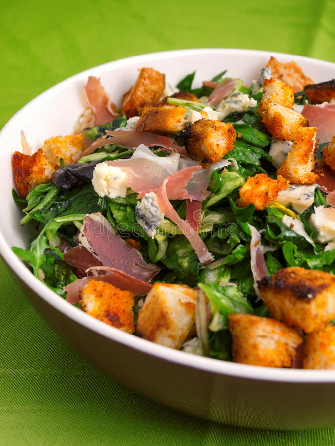 French Provencal Salad. With green salad, bacon, croutons and blue cheese. Vertical shot stock photo