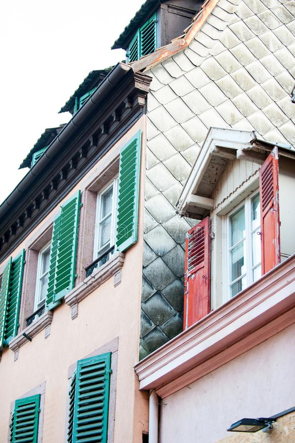 French provencal style multicolored houses with wooden shutters. French provencal style vibrant multicolored houses with wooden shutters and tile in France stock photography