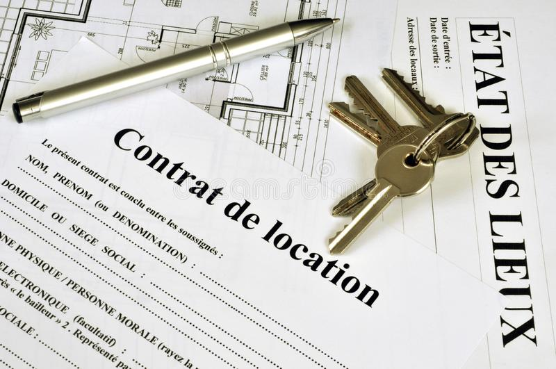 French rental agreement. Keys and pen on a rental agreement in French and an inventory form stock photography