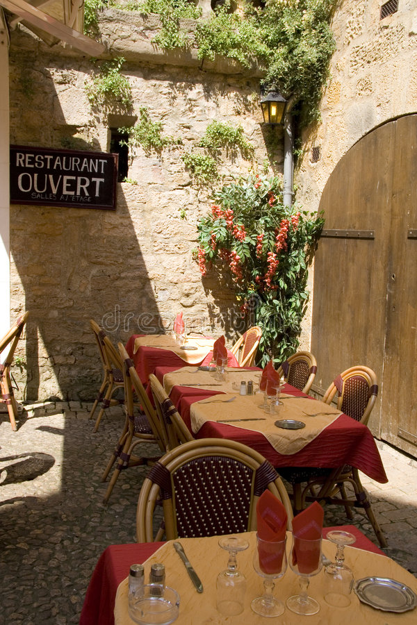 French restaurant. Tables set outside at a French restaurant stock photo