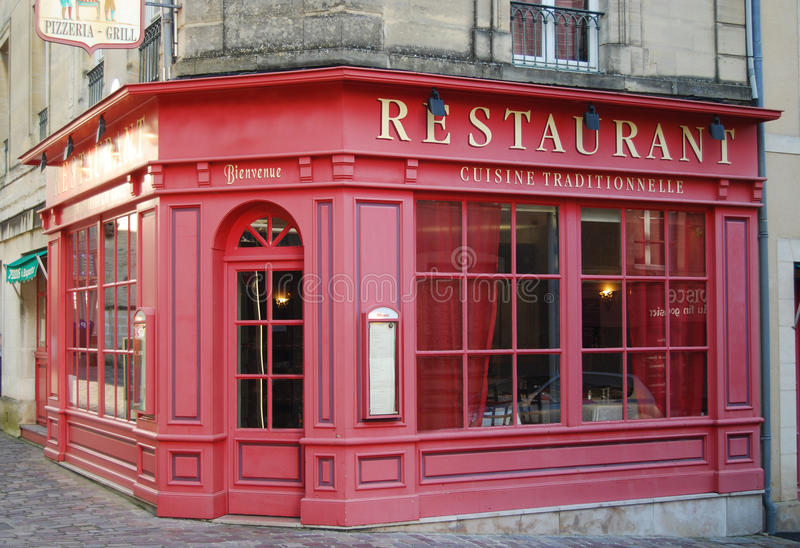 French restaurant. Typical wooden painted facade of French restaurant stock images