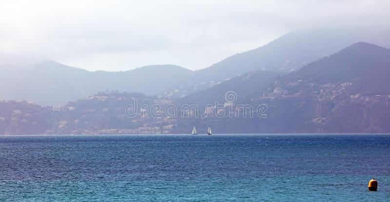 Monaco French riviera, mediterranean coast, Eze, Saint-Tropez, Cannes and Nice. Blue water and luxury yachts. French riviera, Côte d`Azur, mediterranean royalty free stock photography