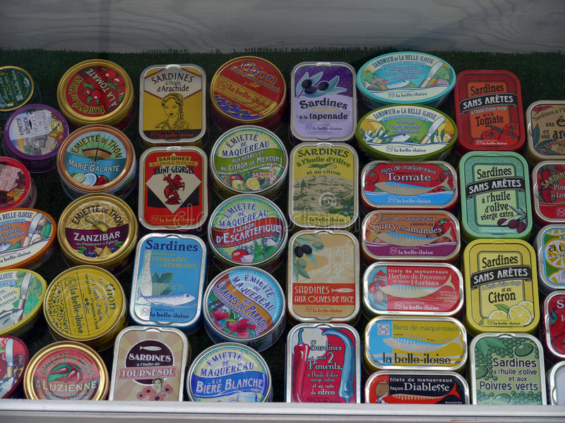 French Sardine tins on shop display. Many flavours, sauces, manufacturers and can designs stock image