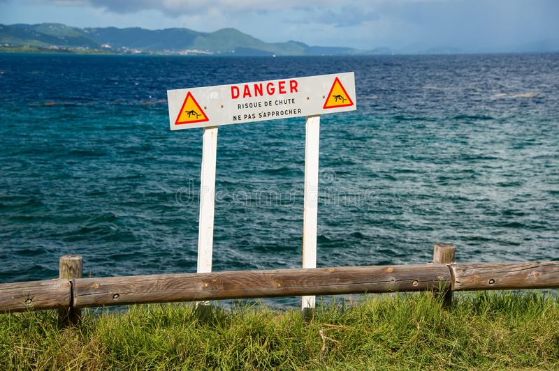 French sign warning people to keep away from a dangerous cliff. Edge in Martinique Do not approach, risk of falling stock photos