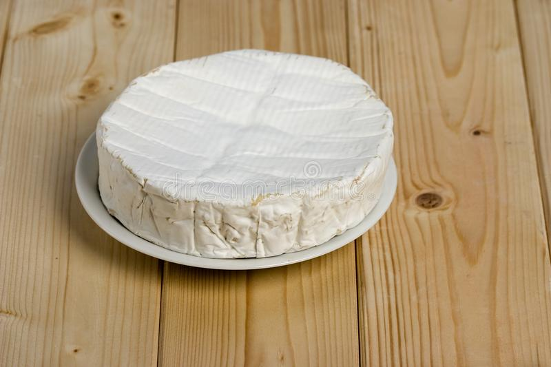 French soft cheese Coulommiers of the Brie family with a bloomy rind. White in color and in the shape of a disc royalty free stock image