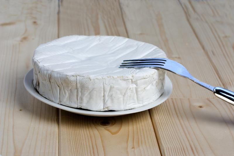 French soft cheese Coulommiers of the Brie family with a bloomy rind. White in color and in the shape of a disc royalty free stock photos