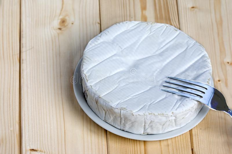 French soft cheese Coulommiers of the Brie family with a bloomy rind. White in color and in the shape of a disc stock photography