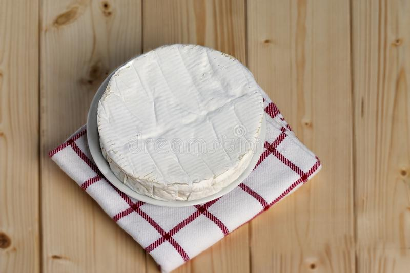 French soft cheese Coulommiers of the Brie family with a bloomy rind. White in color and in the shape of a disc stock image