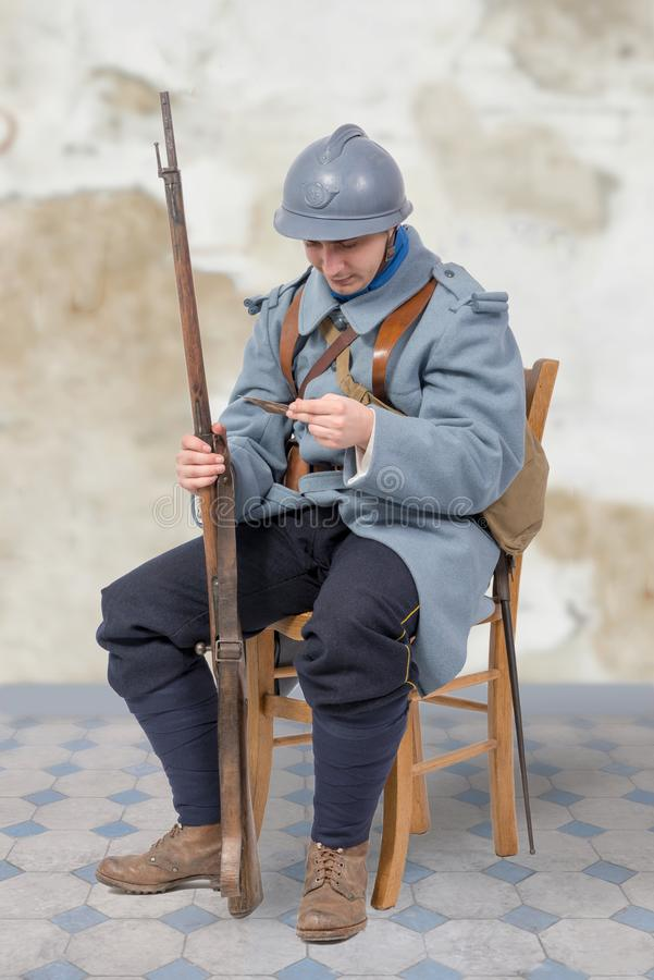 French soldier 1914 1918, sitting on chair, reading letter. A French soldier 1914 1918, sitting on chair, reading letter royalty free stock photos