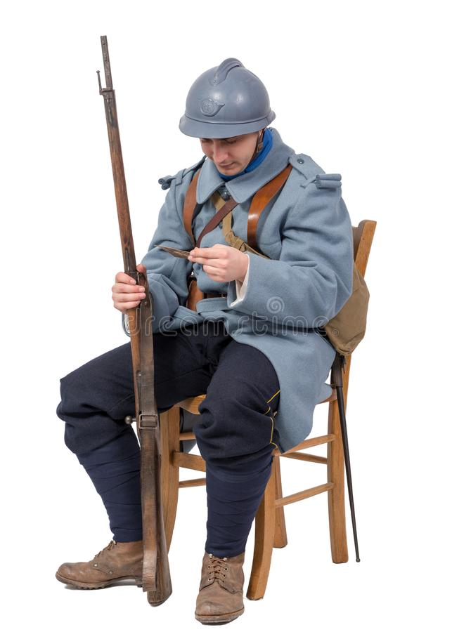 French soldier 1914 1918, sitting on chair, reading letter isolated on white background royalty free stock photos