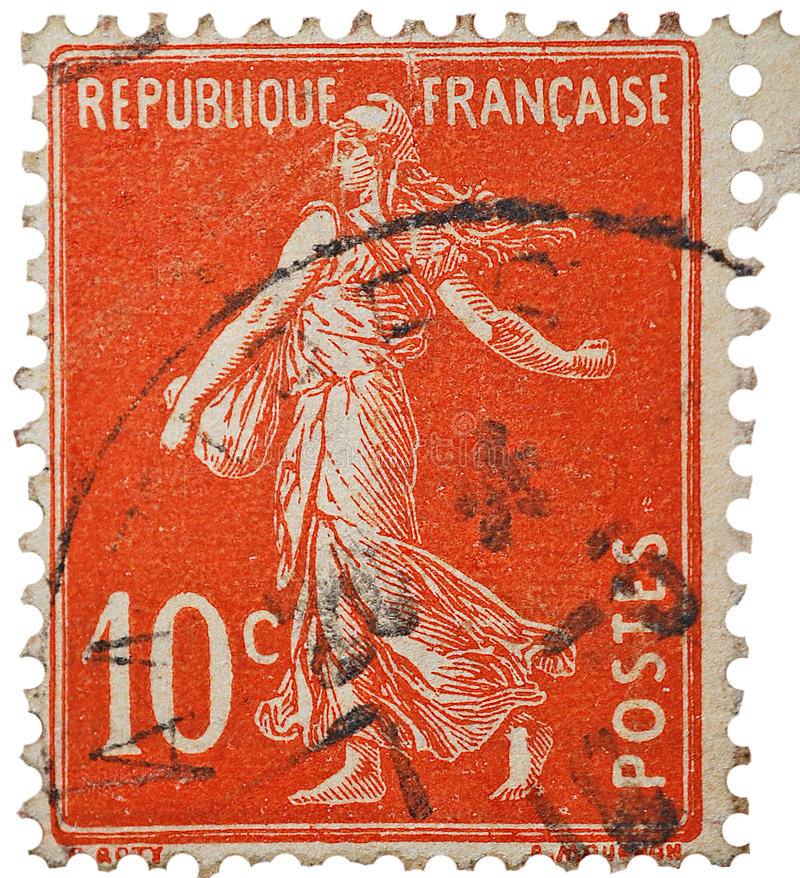 French Stamp Vintage. A 10c cents postage stamp from France. Isolated with a postmark, it depicts Marianne. This could represent philately, scrap booking, and stock image