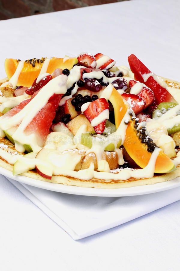 French style crepes with fresh fruits royalty free stock photography