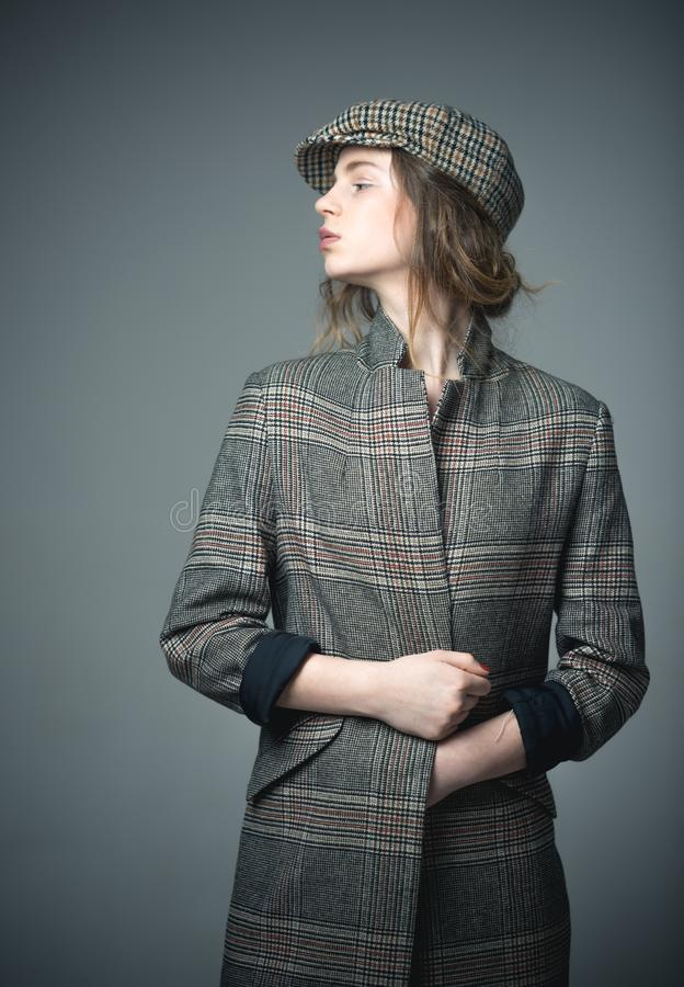 French style. funky beauty. french style of fashion model in checkered beret. french style for woman in checkered jacket royalty free stock photos