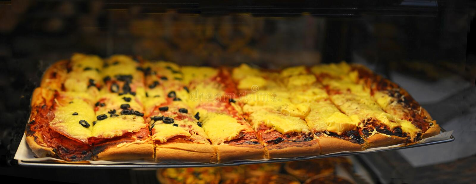 French Style Pizza panorama featuring cheese, tomato and olives stock image