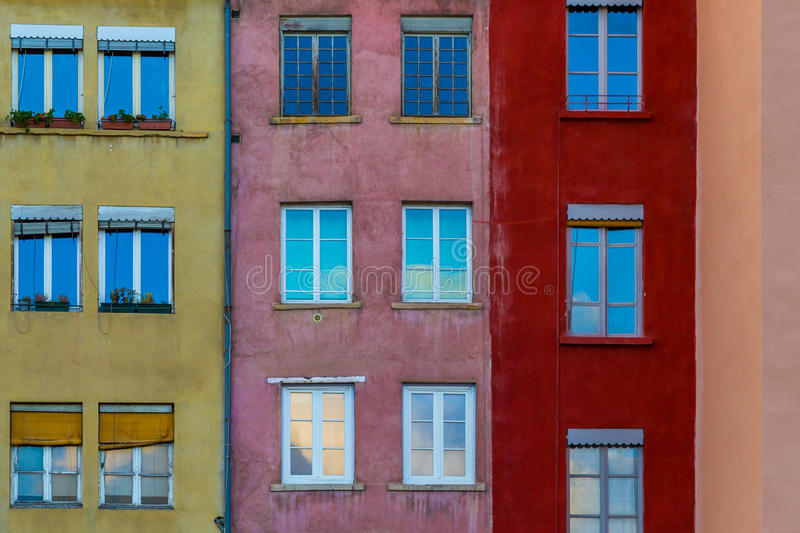 French style town buildings. Different coloured town buildings with windows reflecting the sky stock photography