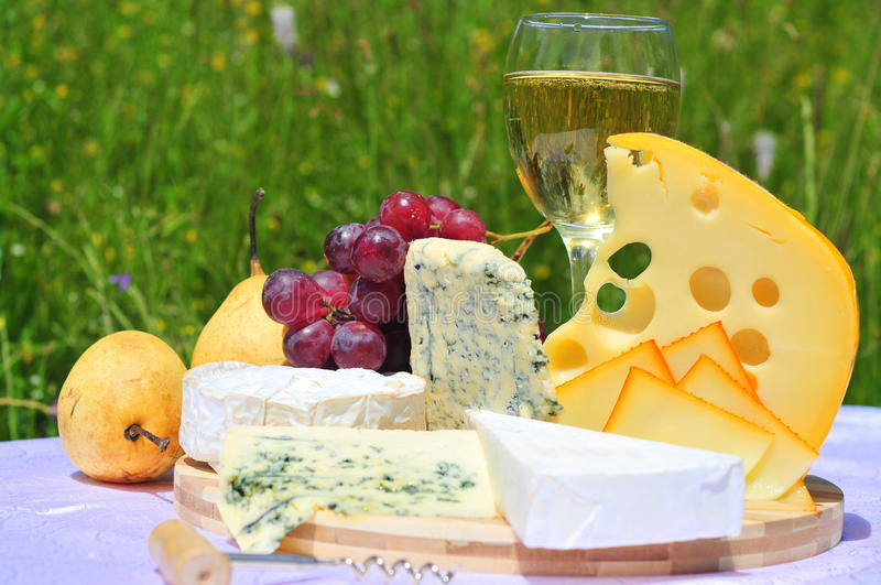 French and swiss cheese with fruits and wine royalty free stock image