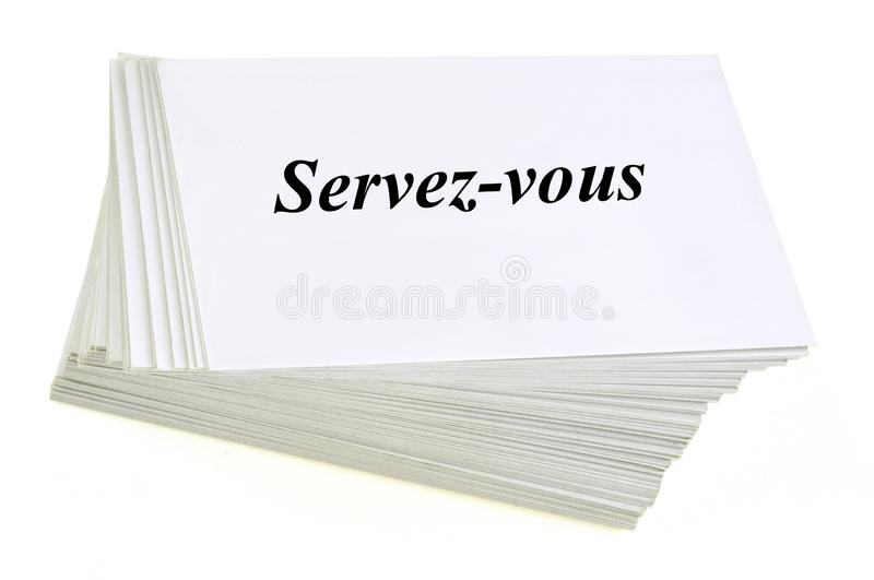 Serve yourself written in French on a stack of cardboard royalty free illustration