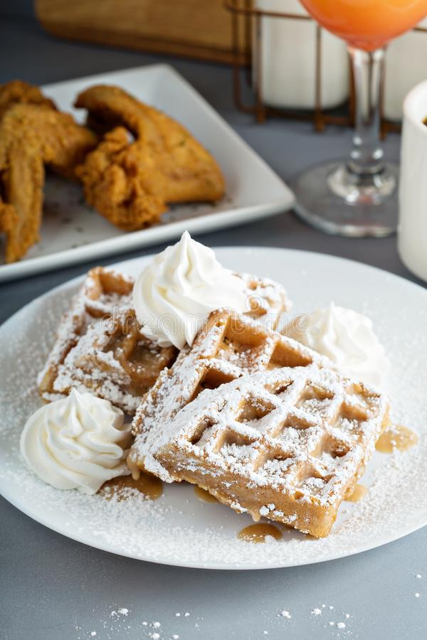 French toast waffles with fried chicken. French toast cinnamon waffles with fried chicken stock photography