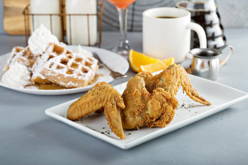 French toast waffles with fried chicken. French toast cinnamon waffles with fried chicken royalty free stock photo