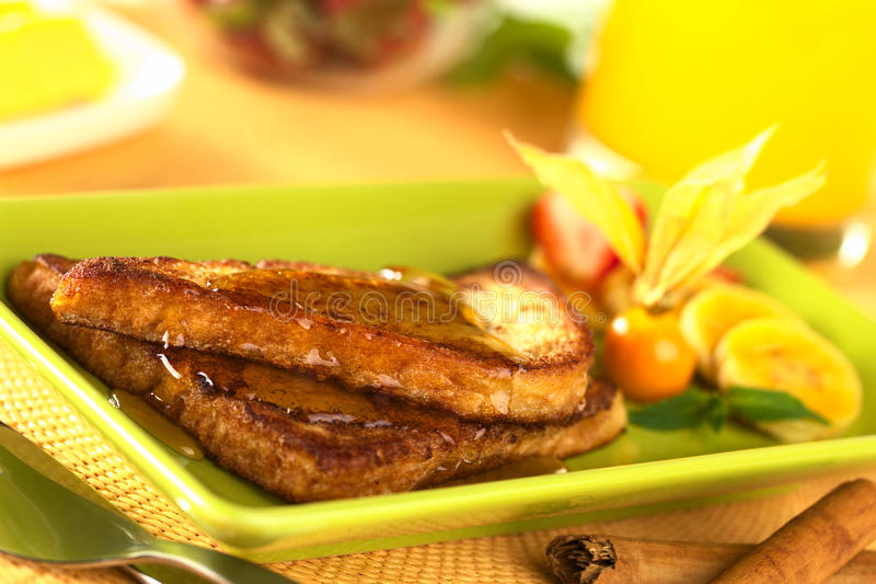 French Toast with Maple Syrup. And fruits (Selective Focus, Focus on the front of the upper slice stock photo