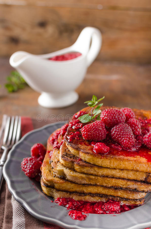 French toast with rapsberries royalty free stock images