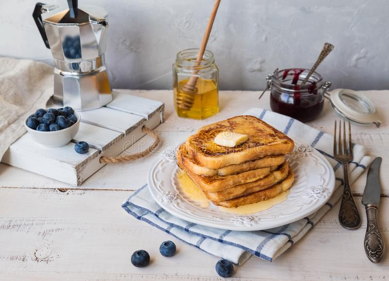 French toasts with butter and blueberries for breakfast stock photos