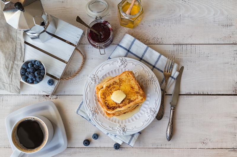 French toasts with butter and blueberries for breakfast stock photography