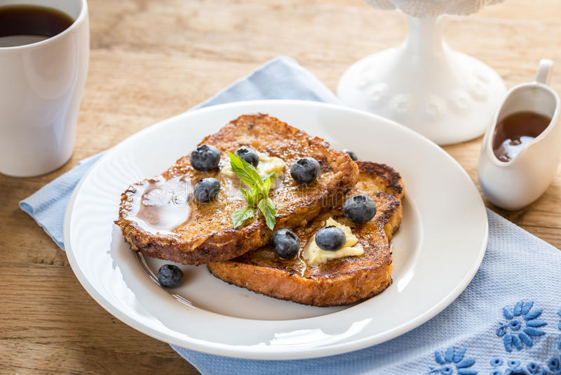 French toasts with fresh blueberries and maple syrup royalty free stock images