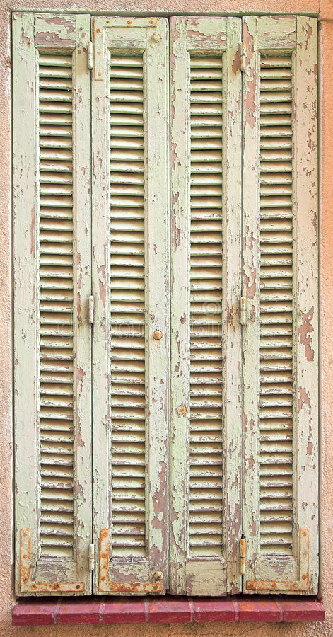 French window with closed shutters royalty free stock image