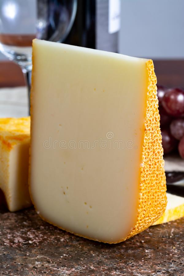 French yellow cheeses, Pur Brebis sheep melk cheese fron Pyrenees and Saint Paulin creamy, mild, semi-soft French cheese from. Pieces of french yellow cheeses royalty free stock photos