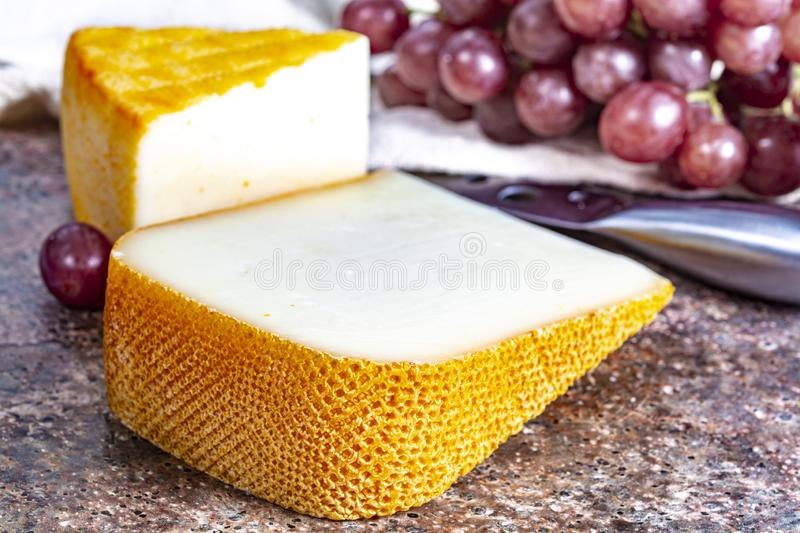 French yellow cheeses, Pur Brebis sheep melk cheese fron Pyrenees and Saint Paulin creamy, mild, semi-soft French cheese from. Pieces of french yellow cheeses stock images