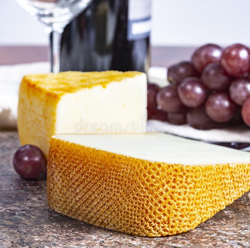French yellow cheeses, Pur Brebis sheep melk cheese fron Pyrenees and Saint Paulin creamy, mild, semi-soft French cheese from. Pieces of french yellow cheeses stock photography