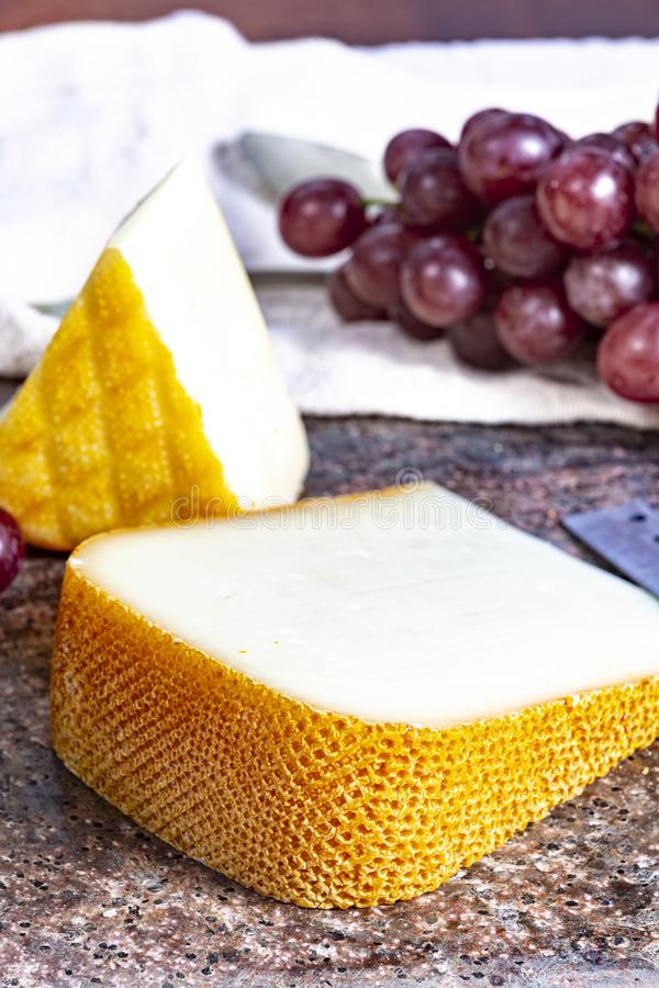 French yellow cheeses, Pur Brebis sheep melk cheese fron Pyrenees and Saint Paulin creamy, mild, semi-soft French cheese from. Pieces of french yellow cheeses stock photos