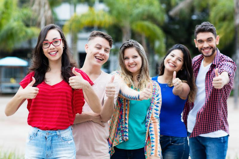 French young adult woman with group of friends in line royalty free stock images