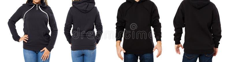 Frente aislado maqueta negra fijado de la sudadera con capucha y visiones traseras - hombre y mujer en mofa negra elegante de la  fotografía de archivo libre de regalías