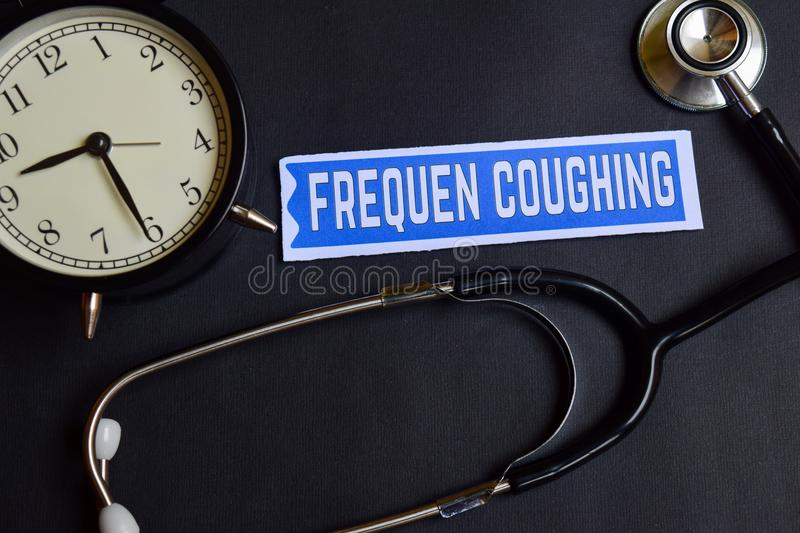 Frequen Coughing on the paper with Healthcare Concept Inspiration. alarm clock, Black stethoscope. stock photography