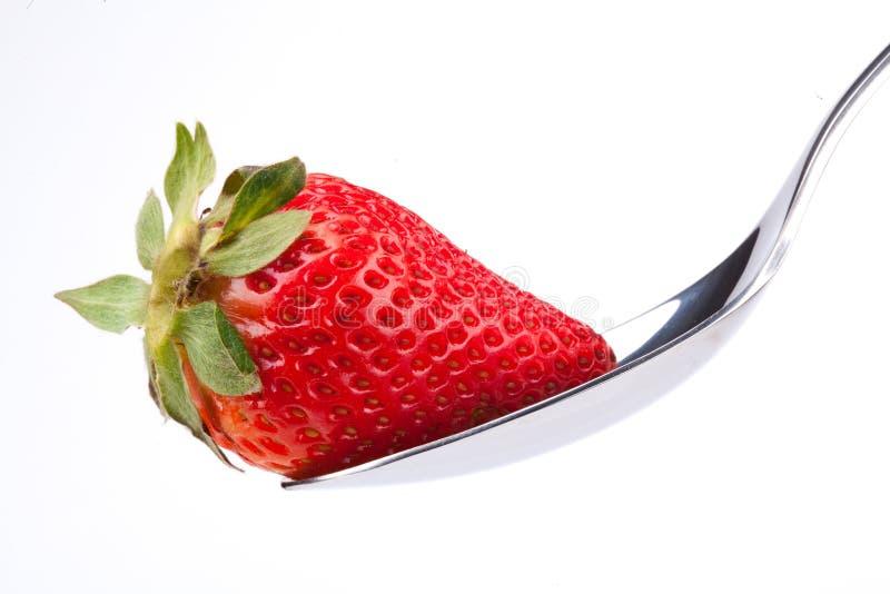 Fresa en la cuchara imagen de archivo