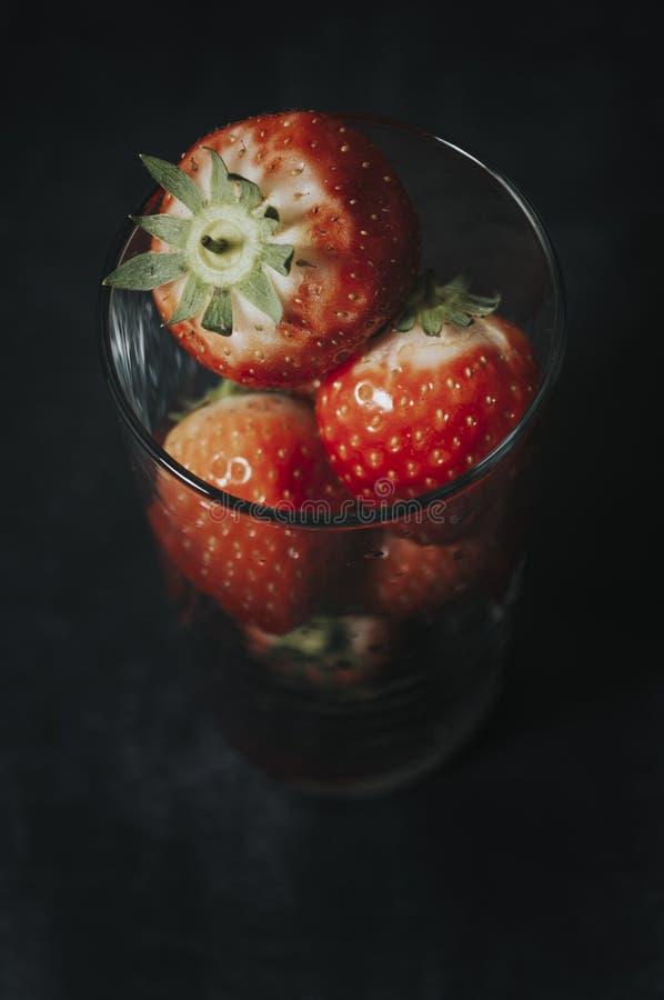 Fresas en vidrio foto de archivo libre de regalías