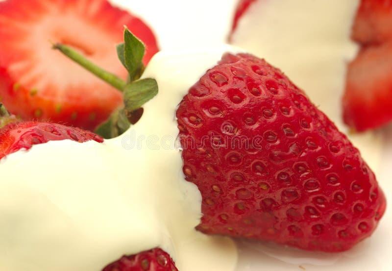 Fresas y crema fotografía de archivo