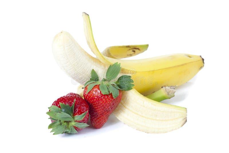 Fresas y plátano imagen de archivo