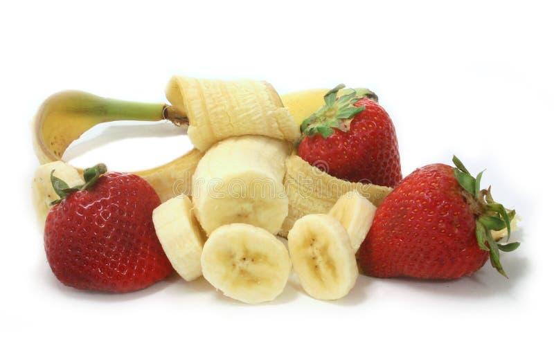 Fresas y plátanos imagen de archivo