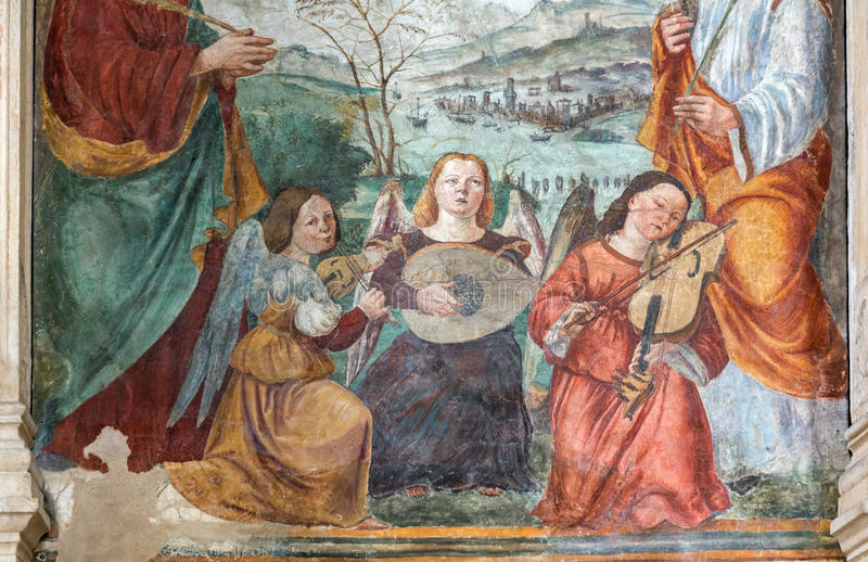 The fresco of angels with the music instruments by Bonino da Campione in the church of The Eremitani as the detail of on tomb of royalty free stock images