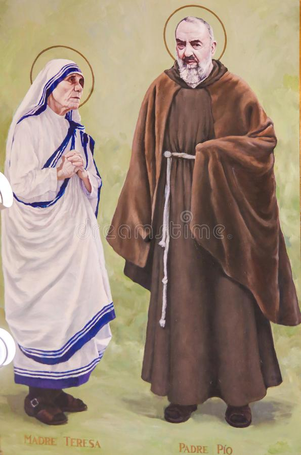Fresco del capellán Pio y madre Teresa en Valencia imagen de archivo