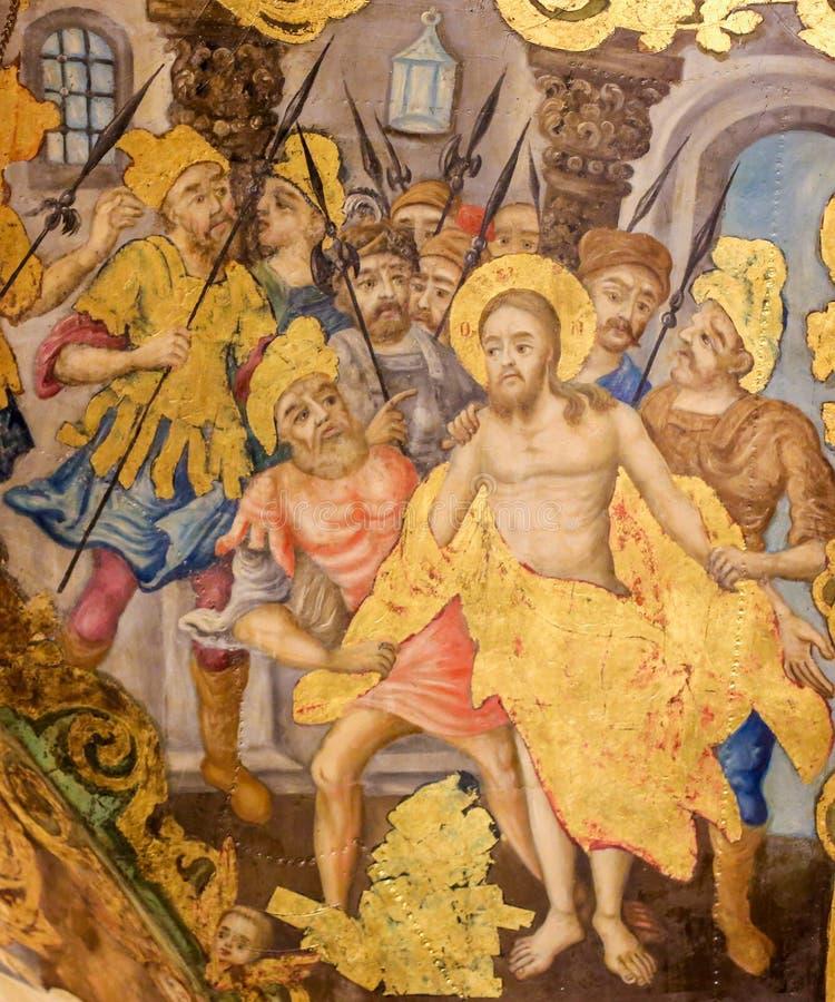 Fresco en la iglesia de Santo Sepulcro, Jerusal?n - Jes?s pel? de su ropa en Viernes Santo fotografía de archivo