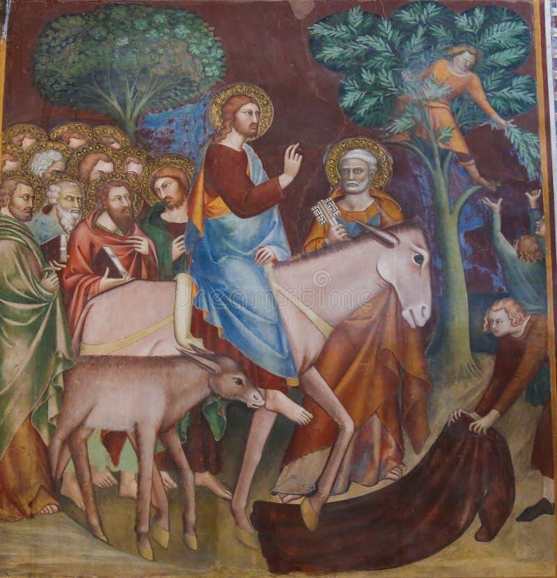 Fresco en San Gimignano - Jesús entra en Jerusalén foto de archivo